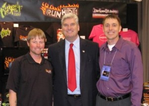 Tom Emmer, center, with kill-the-gays band member Jake McMillan, right