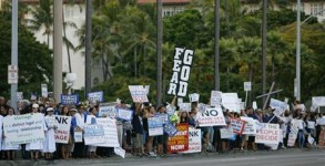 People gather at a rally against same sex marriage at the Hawaii State Capital in Honolulu