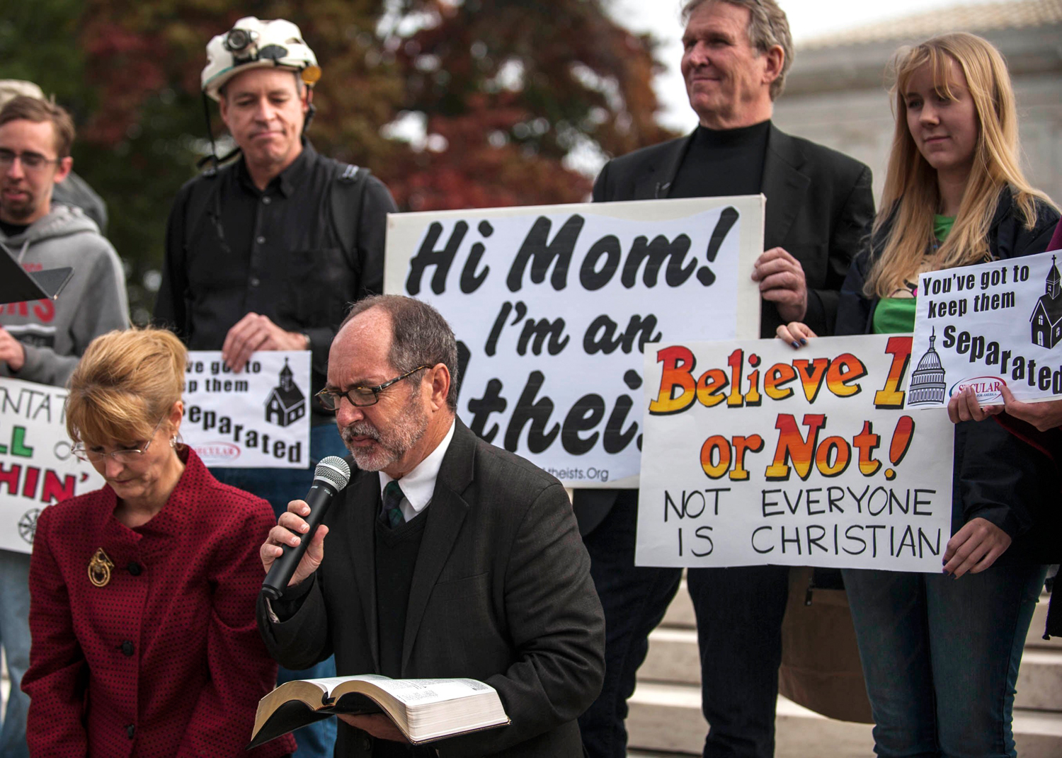 Image: Rev. Mahoney of the Christian Defense Coalition prays outside the U.S. Supreme Court as it hears arguments in the case of Town of Greece, NY v. Galloway, in Washington